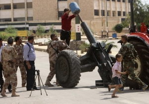 Free Syrian Army fighter a prepare to fire a home-made rocket in Ashrafieh